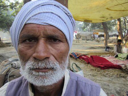 bihar: portrait a man visited fair.SHOT DURING MORNING HOURS ON 02.12.12 AT SONEPUR FAIR, SONEPUR, BIHAR, INDIA.