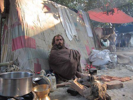 sonepur fair: sadhu waiting beside tent.SHOT DURING MORNING HOURS ON 02.12.12 AT SONEPUR FAIR, SONEPUR, BIHAR, INDIA.