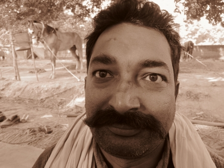 sonepur: PORTRAIT OF A BIHARI.SHOT DURING MORNING HOURS ON 02.12.12 AT SONEPUR FAIR, SONEPUR, BIHAR, INDIA. Editorial