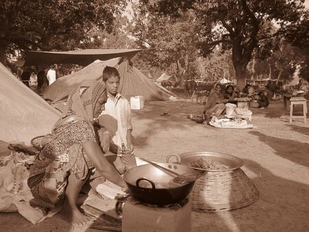 WOMAN SELLING FOOD.SHOT DURING MORNING HOURS ON 02.12.12 AT SONEPUR FAIR, SONEPUR, BIHAR, INDIA.