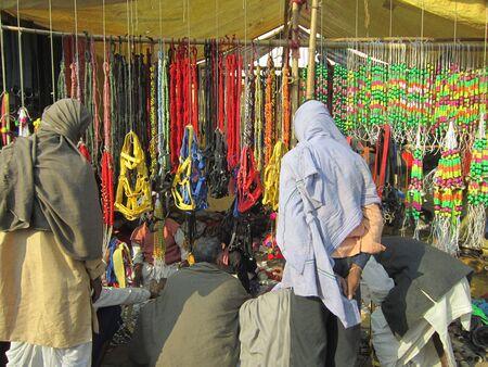 sonepur fair: PEOPLE PURCHASING FROM STALL.SHOT DURING MORNING HOURS ON 02.12.12 AT SONEPUR FAIR, SONEPUR, BIHAR, INDIA.