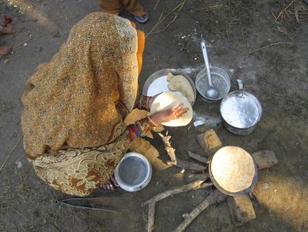 sonepur fair: WOMAN MAKING BREAD.SHOT DURING MORNING HOURS ON 02.12.12 AT SONEPUR FAIR, SONEPUR, BIHAR, INDIA.