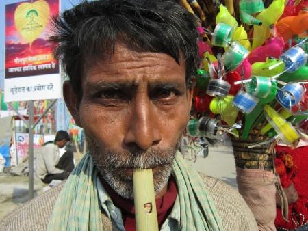 sonepur fair: FLUTE PLAYER.SHOT DURING MORNING HOURS ON 02.12.12 AT SONEPUR FAIR, SONEPUR, BIHAR, INDIA.