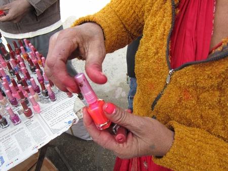 sonepur fair: WOMAN TRYING NAIL POLISH.SHOT DURING MORNING HOURS ON 02.12.12 AT SONEPUR FAIR, SONEPUR, BIHAR, INDIA.