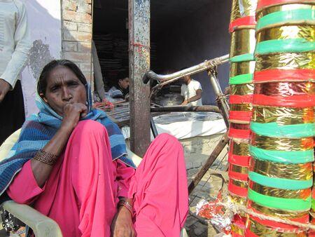 sonepur fair: WOMAN SELLING WHISTLES.SHOT DURING MORNING HOURS ON 02.12.12 AT SONEPUR FAIR, SONEPUR, BIHAR, INDIA. Editorial