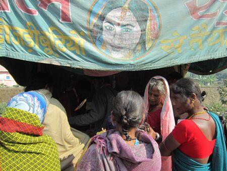 sonepur fair: WOMAN PURCHASING GOODS.SHOT DURING AFTERNOON HOURS ON 02.12.12 AT SONEPUR FAIR, SONEPUR, BIHAR, INDIA.