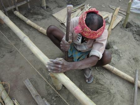 sonepur fair: MAN BUILDING TENTS.SHOT DURING AFTERNOON HOURS ON 02.12.12 AT SONEPUR FAIR, SONEPUR, BIHAR, INDIA.