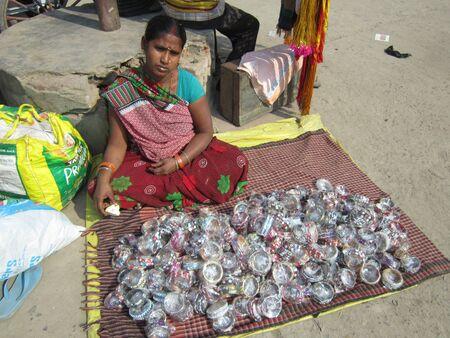 sonepur fair: WOMAN SELLING BANGLES AT FAIR.SHOT DURING MORNING HOURS ON 02.12.12 AT SONEPUR FAIR, SONEPUR, BIHAR, INDIA. Editorial