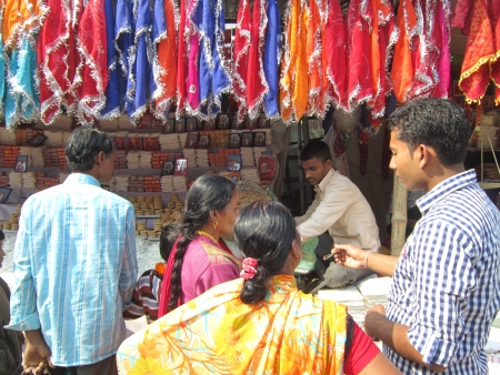 PEOPLE PURCHASING AT FAIR.SHOT DURING MORNING HOURS ON 02.12.12 AT SONEPUR FAIR, SONEPUR, BIHAR, INDIA.
