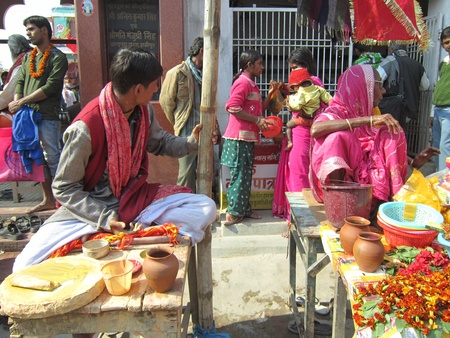 PUJARIS IN FRONT OF TEMPLES.SHOT DURING MORNING HOURS ON 02.12.12 AT SONEPUR FAIR, SONEPUR, BIHAR, INDIA. Editorial