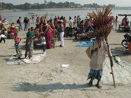 sonepur fair: MAN SELLING FLUTE ON RIVERBANK.SHOT DURING MORNING HOURS ON 02.12.12 AT SONEPUR FAIR, SONEPUR, BIHAR, INDIA.