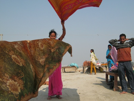 WOMAN DRYING CLOTHES.SHOT DURING MORNING HOURS ON 02.12.12 AT SONEPUR FAIR, SONEPUR, BIHAR, INDIA. Stock Photo - 17228453