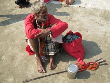 sonepur fair: SADHU NWAITING AT FAIR.SHOT DURING MORNING HOURS ON 02.12.12 AT SONEPUR FAIR, SONEPUR, BIHAR, INDIA.