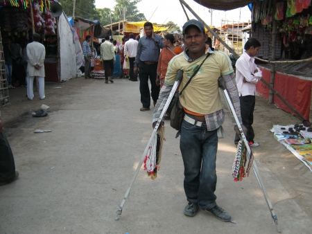 bihar: PHYCALLY CHALLENGED MAN AT FAIR.SHOT DURING AFTERNOON HOURS ON 02.12.12 AT SONEPUR FAIR, SONEPUR, BIHAR, INDIA.