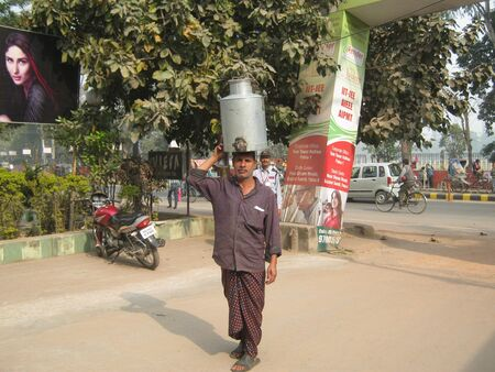 milkman: UNIDENTIFIED MILKMAN CARRIES MILK IN TRADITIONAL WAY ON HEAD. SHOT ON MORNING HOURS ON FEBRUARY 13, 2013 AT PATNA, BIHAR, INDIA.