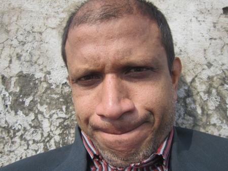 resolved: PORTRAIT OF RESOLVED MIDDLE AGED BALD MAN