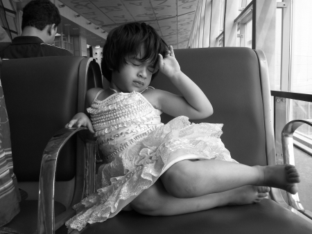 calcutta: UNIDENTIFIED GIRL AT AIRPORT LOUNGE. SHOT AT MORNING HOURS ON MARCH 16 IN CALCUTTA, INDIA. Editorial