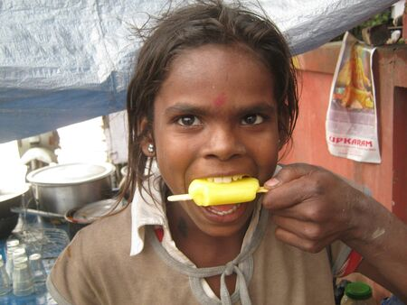 UNIDENTIFIED GIRL ENJOYS ICECREAM. SHOT DURING AFTERNOON HOURS ON APRIL 19, 2013 IN PATNA, INDIA.