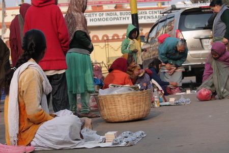 bodhgaya: Women exchange money on road, Shot at Bodhgaya, India, afternoon hours on 26.12.14 Editorial