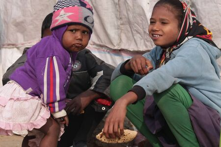 slums: Slum people have meal, Shot at Bodhgaya, India, afternoon hours on 26.12.14