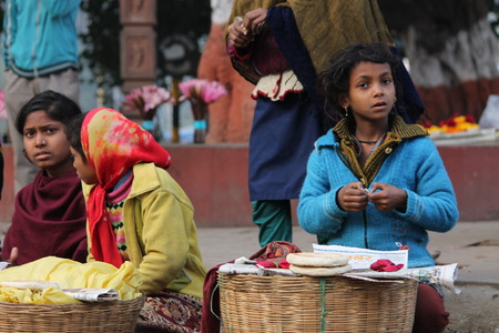 bodhgaya: Woman sale food on road. Shot at Bodhgaya, India, afternoon hours on 26.12.14