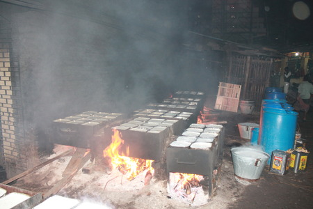 milkman: Milkman boils milk before sale. Travel Patna Junction. Shot at Patna Junction, Patna, Bihar on 04.02.2015. Evening hours.