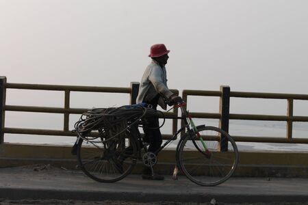 gandhi: Traffic   activities at Mahatma Gandhi Bridge. A travel photo. Shot at afternoon hours on 15.02.15 at Gandhi bridge, Bihar, India.
