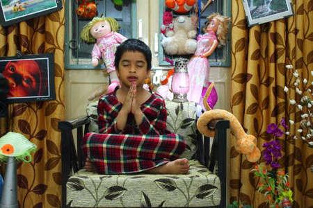 meditates: Indian Girl meditates at home.