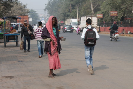 gandhi: Travel Gandhi Maidan. Indian poor people. Shot at morning hours at Gandhi Maidan,Patna, Bihar on 18.02.2015