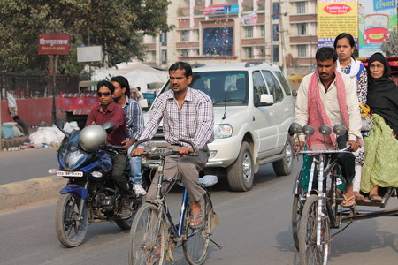 unsafe: Unsafe driving without helmet. Shot at Gandhi Maidan, Patna, Bihar at afternoon hours on 19.02.2015.