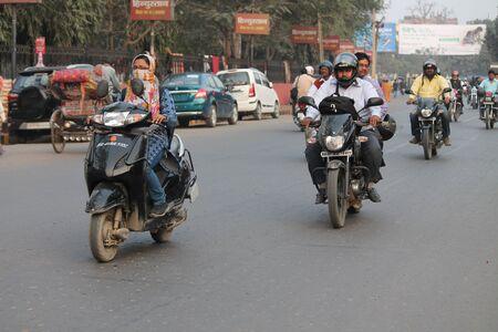 maidan: Unsafe riding without helmet. Shot at Gandhi Maidan, Patna, Bihar at afternoon hours on 19.02.2015. Editorial
