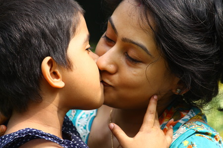 mother kissing daughter: Indian mother and daughter.