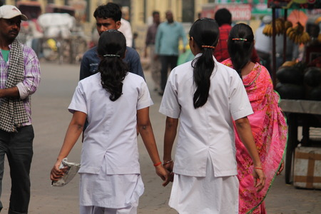 Indian nurses at road. Street photo, Shot at Gandhi Maidan, Patna, Bihar, India on 25.02.15 at afternoon hours.