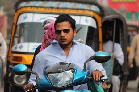 maidan: Unsafe driving. Street photo, Shot at Gandhi Maidan, Patna, Bihar, India on 25.02.15 at afternoon hours.