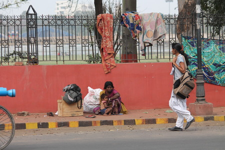 Indian poor at road. Street photo, Shot at Gandhi Maidan, Patna, Bihar, India on 25.02.15 at afternoon hours.