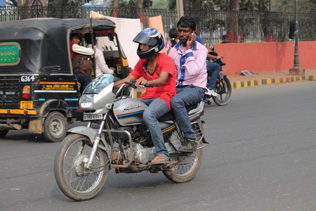 Unsafe driving. Street photo, Shot at Gandhi Maidan, Patna, Bihar, India on 25.02.15 at afternoon hours.