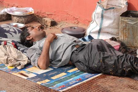 Indian poor at foot path. Street photo, Shot at Gandhi Maidan, Patna, Bihar, India on 25.02.15 at afternoon hours. Editorial