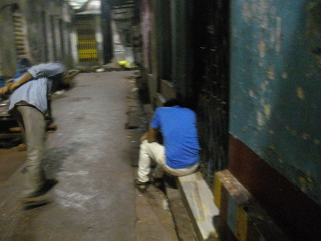 brothel: Checking a inebriated visitor. Night life. Travel Sonagachi. Shot at Sonagachi, Kolkata, India on 08.03.15, night hours. Sonagachi is Asias largest red-light district.