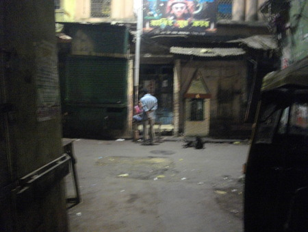 brothel: Bargaining with a prostitute. Night life. Travel Sonagachi. Shot at Sonagachi, Kolkata, India on 08.03.15, night hours. Sonagachi is Asias largest red-light district. Editorial