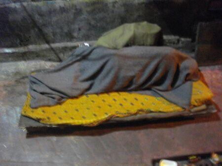 A man sleeps at pavement. Night life. Travel Sonagachi. Shot at Sonagachi, Kolkata, India on 08.03.15, night hours. Sonagachi is Asias largest red-light district. Editorial