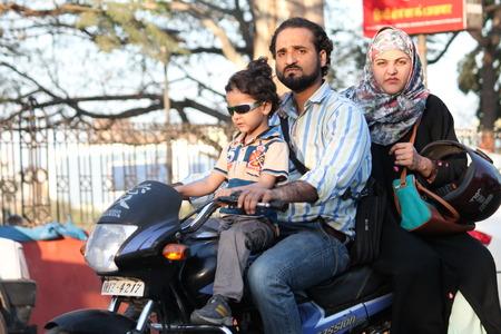 maidan: Unsafe riding. Street photo. Shot at Gandhi Maidan, Patna, India at afternoon hours on 11.03.15.