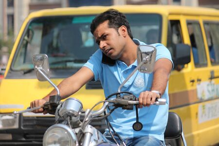 unsafe: Unsafe driving. Shot at Gandhi Maidan ,Patna, India at afternoon hours on 13.03.15. Editorial