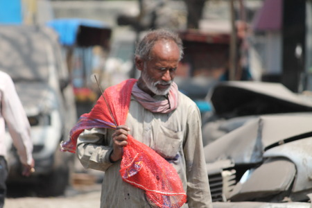 gandhi: Indian poor. Shot at Gandhi Maidan ,Patna, India at afternoon hours on 13.03.15.