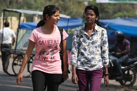 gandhi: Indian woman returns from college. Shot at Gandhi Maidan ,Patna, India at afternoon hours on 13.03.15. Editorial