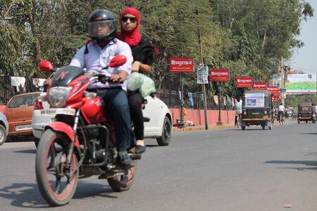 Unsafe riding. Shot at Gandhi Maidan, Patna on 13.03.2015 at afternoon hours. Editorial