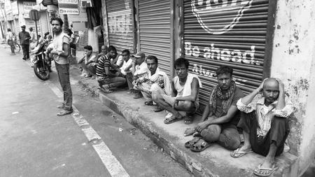 laborers: Laborers wait for work. Shot at morning hours on 28.06.15 at Patna, Bihar, India.