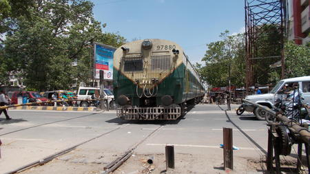 Train crosses a manned level crossing in Bailey road. Shot at Patna, Bihar, India on  20.06.15 morning hours.