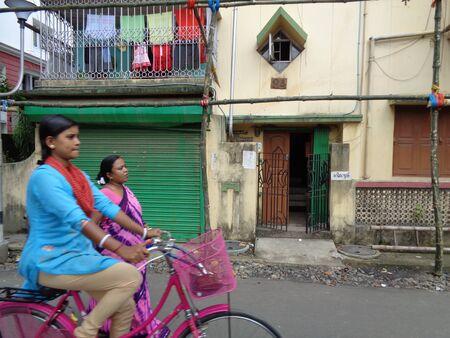 street shot: Girl cycles at street. Shot at Kolkata, afternoon on 13,08,16.