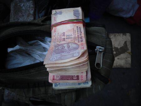 Money on sale at Holi at Kolkata, India. March 2017. Stock Photo