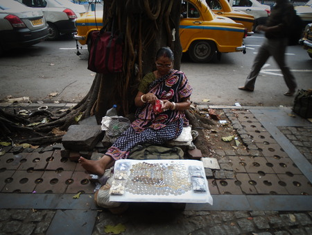 Coinseller. Dealer of coins. Dalhousie. Holi, Kolkata. Shot afternoon on 11.03.17 at Kolkata, India.